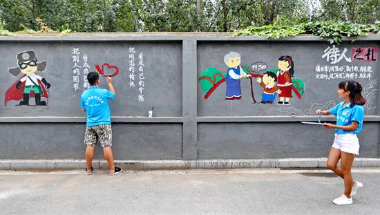 """澳门星际岛:""""护城使者""""扮靓社区文化墙"""