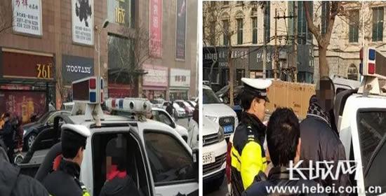 两非法收取停车费人员分别被带走。郭俊岭供图